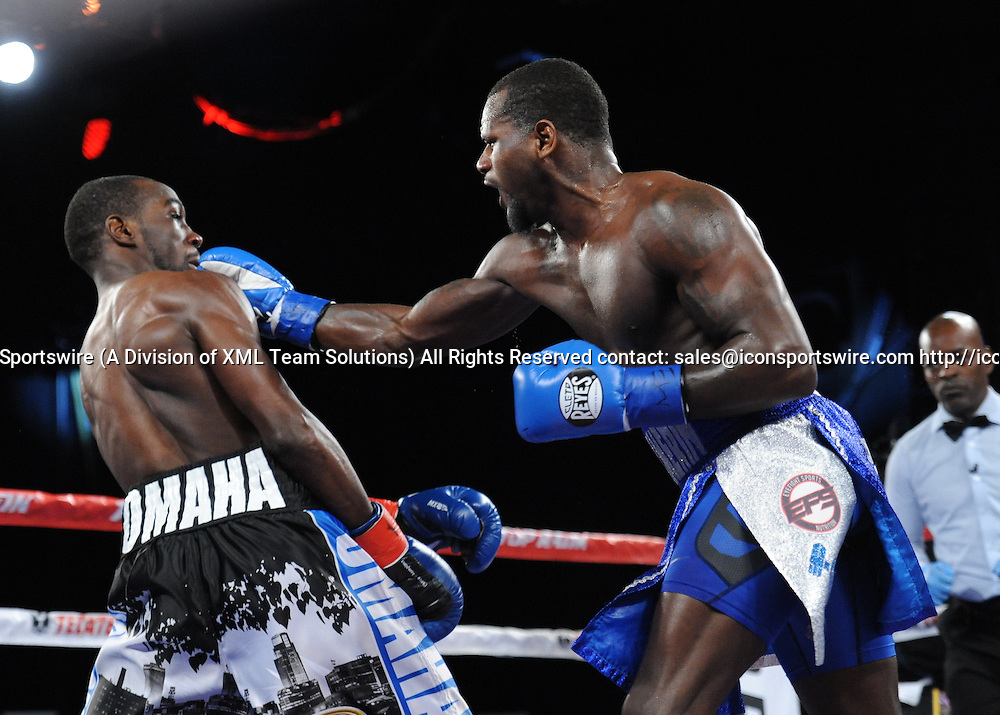 February 27, 2016: Henry Lundy lands a shot as Terrance Crawford retains the WBO Lightweight title by TKO of Round 5, while in action against Henry Lundy during a boxing match at the Theater at Madison Square Garden in New York, New York