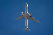 An Airbus A350-941 jet airliner (ET-AVC) with Ethiopian Airlines flies overhead in blue skies on its flight-path into London Heathrow airport, on 8th August 2018, in London, England.