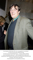 Comedian STEPHEN FRY at a reception in London on 2nd November 2002.PFS 58