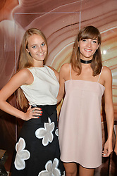 Left to right, sisters PETRA PALUMBO and LANA PALUMBO at a party to celebrate the launch of Baar & Bass, 336 Kings Road, London on 9th September 2014.