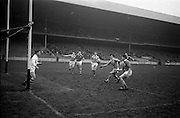 16/02/1964<br /> 02/16/1964<br /> 16 February 1964<br /> Railway Cup Football Semi Final: Munster v Ulster at Croke Park, Dublin. All eyes on the ball as this Munster attack nears the Ulster goalmouth. The ball was cleared by Ulster full badk L. Murphy (second from right).