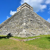Description of El Castillo at Chichen Itza, Mexico<br /> El Castillo is a stepped-pyramid at the center of Chichen Itza's Great Plaza. The massive, nine-tiered limestone structure measures 98.5 feet tall with a 180.5 foot base. The Castle (also called the Temple of Kukulcan) is an amazing pre-Columbian structure of design, engineering and workmanship for its construction in the 9th to the 12th centuries. Since 2006, visitors can no longer climb the staircases of El Castillo. Tourists are similarly roped off from the other 30 buildings at this archaeological site.