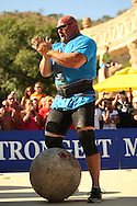 Nick Best (USA) prepares his grip for the final and heaviest Atlas Stone before placing it on the platform during the final rounds of the World's Strongest Man competition held in Sun City, South Africa.