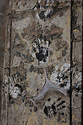 Traces of human handprints left on a derelict wall in east London.