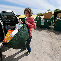 Thomas Wells | BUY at PHOTOS.DJOURNAL.COM<br /> Linda Remmers of Mooreville drops off her recycling at the bins on Commerce Street in Tupelo on Monday. Remmers saves her recycleable materials and then drops them off when she comes to Tupelo.
