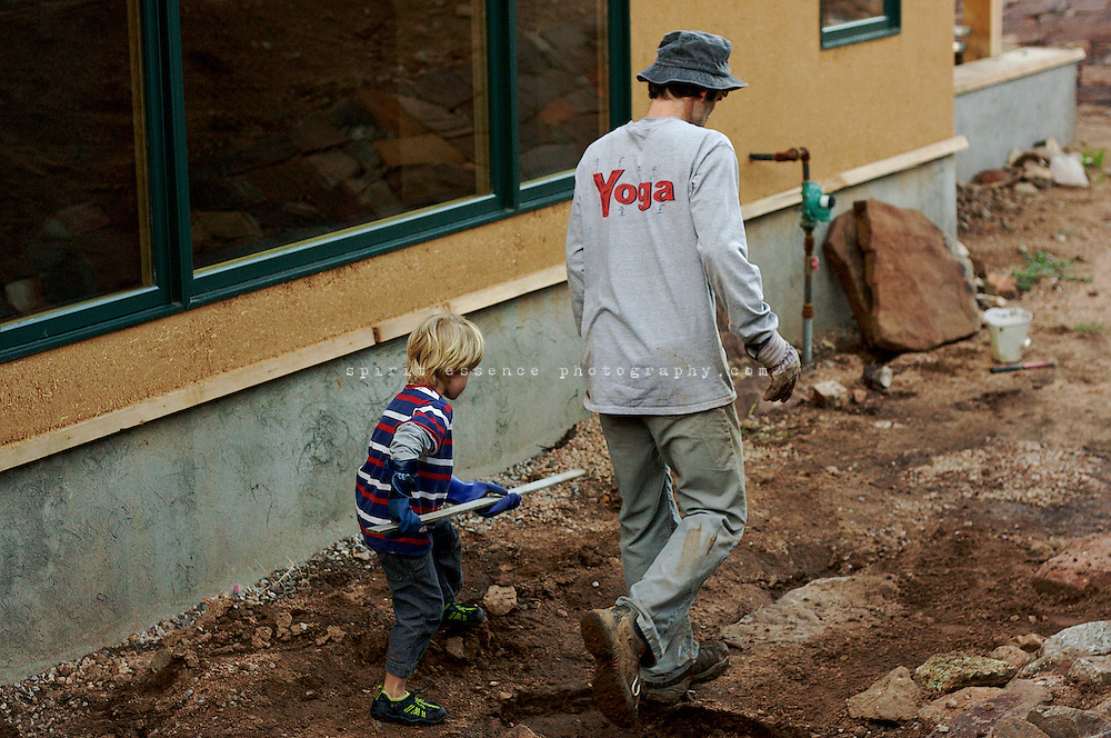 Tias Little and son, Eno, build a rock path together