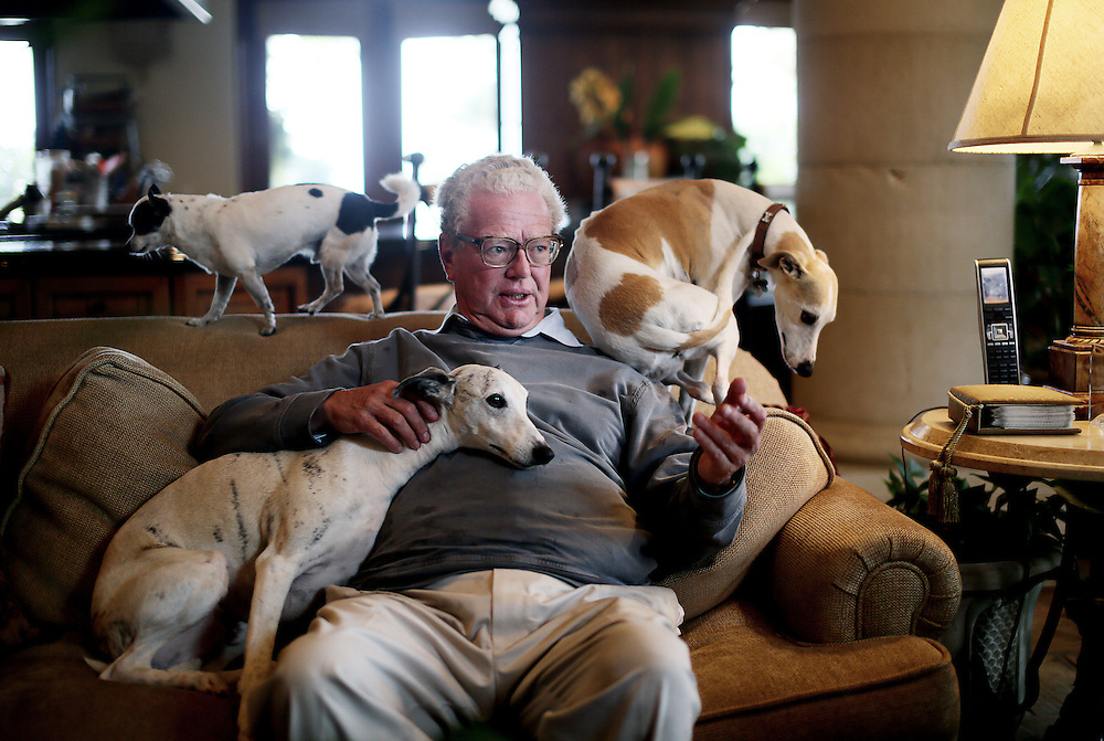 William Lerach sits with his Dogs in a living room area at his estate in the La Jolla Farms area of La Jolla, CA on Monday, May 6, 2013.  The 96 homes in San Diego's La Jolla Farms are some of the fanciest in town, with special beach access and panoramic views of the Pacific Ocean. At the same time, the neighborhood serves as a de facto parking lot for surfers and, because it sits across the street from a University, is a pathway for college kids who make daily treks to a nearby vista that is a popular place to smoke pot. Residents include billionaire Ron Burkle and Qualcomm president Steve Altman along with fallen moguls such as Ted Waitt, founder of Gateway computers, and William Lerach.(Photo by Sandy Huffaker for The Wall Street Journal)<br /> LA JOLLA <br /> 24349