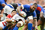 Samoa back row Faifili Levave is tackled by Japan scrum half Fumiaki Tanaka during the Rugby World Cup Pool B match between Samoa and Japan at stadium:mk, Milton Keynes, England on 3 October 2015. Photo by David Charbit.