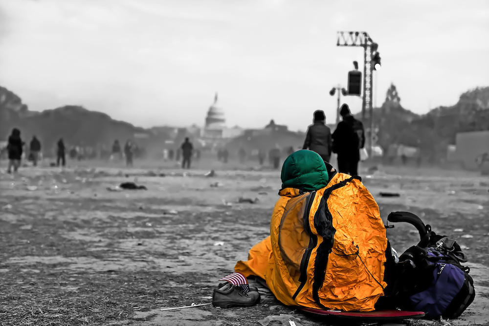Attendee to Barack Obama's inauguration on The Mall covers up to stay warm. Copyright 2009 Reid McNally.