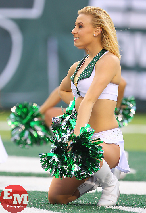 Dec 22, 2013; East Rutherford, NJ, USA; A member of the New York Jets Flight Crew performs during the second half of the game between the New York Jets and the Cleveland Browns at MetLife Stadium.  The Jets defeated the Browns 24-13.