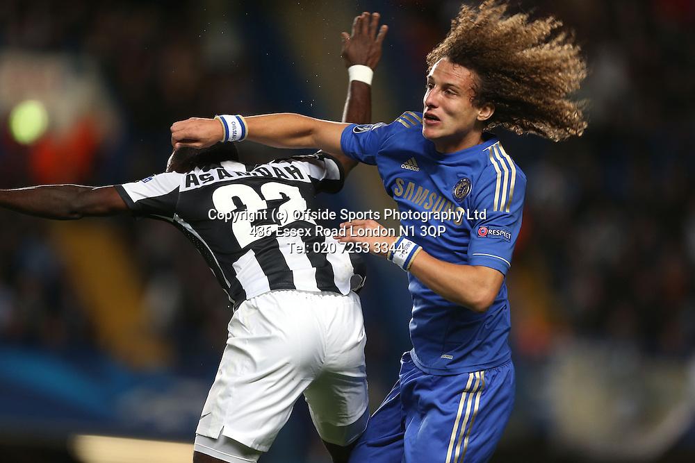 19 September 2012 Champions League football. Chelsea v Juventus.<br /> David Luiz challenges Asamoah of Juve.<br /> Photo: Mark Leech.