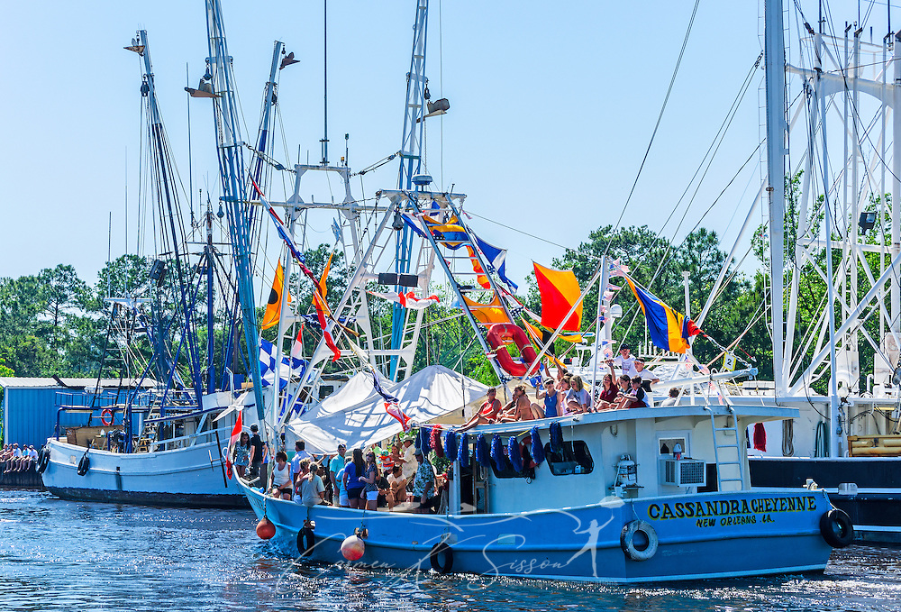 """""""Cassandra Cheyenne,"""" based out of New Orleans, participates in the 65th annual Blessing of the Fleet in Bayou La Batre, Alabama, May 4, 2014. The first fleet blessing was held by St. Margaret's Catholic Church in 1949, carrying on a long European tradition of asking God's favor for a bountiful seafood harvest and protection from the perils of the sea. The highlight of the event is a blessing of the boats by the local Catholic archbishop and the tossing of a ceremonial wreath in memory of those who have lost their lives at sea. The event also includes a land parade and a parade of decorated boats that slowly cruise through the bayou. (Photo by Carmen K. Sisson/Cloudybright)"""