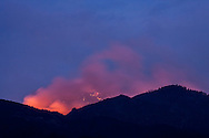 The gusty winds spread the Dean Peak wildfire east towards Blake Ranch as darkness falls on the Hualapai Mountains in Arizona