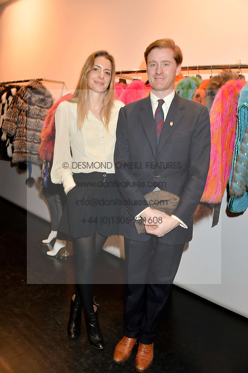 LUCY DELACHEROIS DAY and TOM NAYLOR-LEYLAND at a preview of the Hockley Autumn -Winter 2013/2014 Collection at Hockley, 20 Conduit Street, London on 26th November 2013.