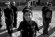 Young Palestinian boys stand at attention during an August 05, 2007 HAMAS sponsored summer camp in the Nuseirat camp in the Gaza strip. Up to 100,000 kids from age 7-16 are given military style training 6 days a week at  Hamas camps across the Gaza strip  for 3 hours per day.