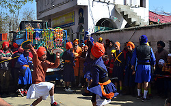 April 13, 2017 - Anantnag, Jammu & Kashmir, India - Kashmiri  Sikh show off their skills in the Sikh martial art known as 'Gatka' while participating in a procession at Cahtisinghpora Anantnag  some 55 Km from Srinagar the summer Capital of Kashmir. The festival has special significance for Sikhs since it marks the day in 1699, when their tenth Guru Gobind Singh organized the order of the Khalsa, a collective body of initiated Sikhs. (Credit Image: © Muneeb Ul Islam/Pacific Press via ZUMA Wire)