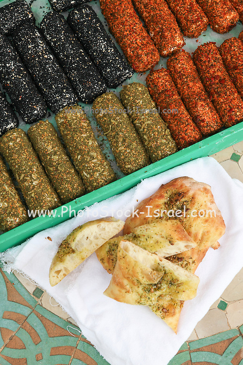 An assortment of goat milk cheese coated in herbs and spices