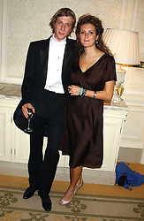 PRINCE MAX ZU SALM and MISS LEONORA BEAMISH at a dinner hosed by Moet & Chandon at their headquarters at 13 Grosvenor Crescent, London on 12th October 2005.<br /><br />NON EXCLUSIVE - WORLD RIGHTS