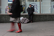 28 February 2013. New York, NY. A homeless woman stands outside the Port Authority Bus Terminal. Photograph by Sehar Mughal/CUNY Journalism Photo