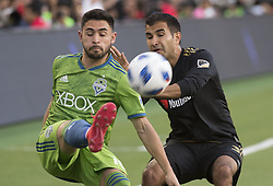 April 29, 2018 - Los Angeles, California, U.S - 29 April 2018, Los Angeles, Ca.,The Los Angeles Football Club (LAFC) beat the Seattle Sounders in the inaugural game at the new Banc of California Stadium. Pictured is Sounders' Alex Roldan going against LAFC's Steven Beitashour. (Credit Image: © Prensa Internacional via ZUMA Wire)