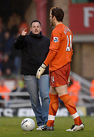 Photo: Daniel Hambury.<br />Arsenal v Cardiff City. The FA Cup. 07/01/2006.<br />A Cardiff fan runs onto the pitch and confronts Arsenal 'keeper Manuel Almunia.