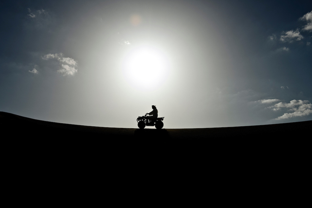 Al-Ain (Abu Dhabi), United Arab Emirates 04 April 2009. Arabs and tourist drive cuatris in the  desert of AL Ain.