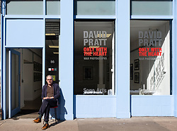 Craig Wallace editor of Sogo Arts magazine  outside the Sogo Arts gallery on Saltmarket in Glasgow, Scotland, UK
