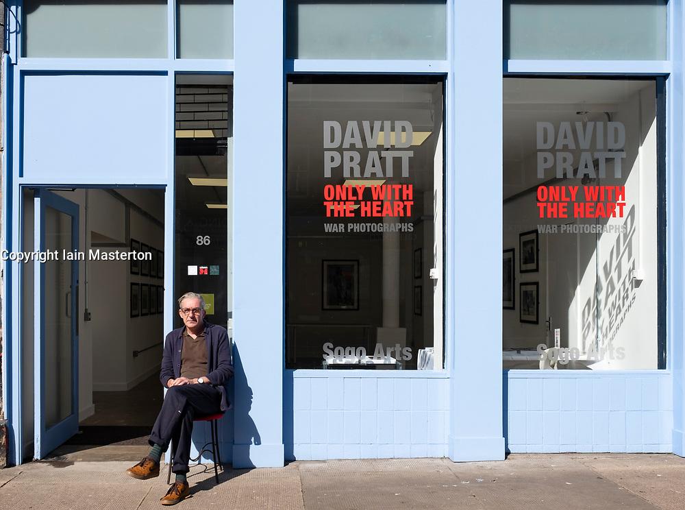 Craig Wallace editor of Sogo Arts magazine  outside the Sogo Arts gallery on Saltmarket in Glasgow, Scotland, UK
