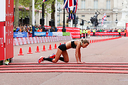 © Licensed to London News Pictures. 28/04/2019. London, UK. A women runner falls down and passes the finish line   at the London Marathon 2019. Photo credit: Dinendra Haria/LNP