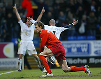 Photo: Aidan Ellis.<br /> Bolton Wanderers v Arsenal. The Barclays Premiership.<br /> 03/12/2005.<br /> Arsenal's Lens Lehman is beaten for a second time as goal svorer Stelios celebrates with Kevin nolan after the second goal