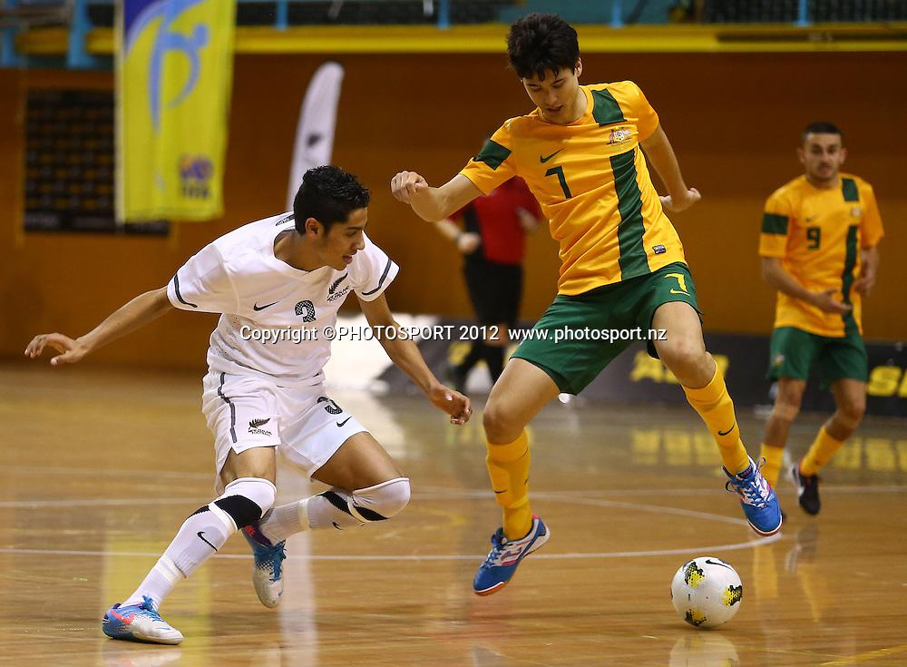 Dylan Manichum of New Zealand is tackled by Tobias Seeto of Australia. ASB Trans Tasman Cup, Futsal Whites v Futsal Roos, ASB Stadium, Kohimarama, FSaturday 22 September 2012. Photo: Simon Watts/photosport.co.nz