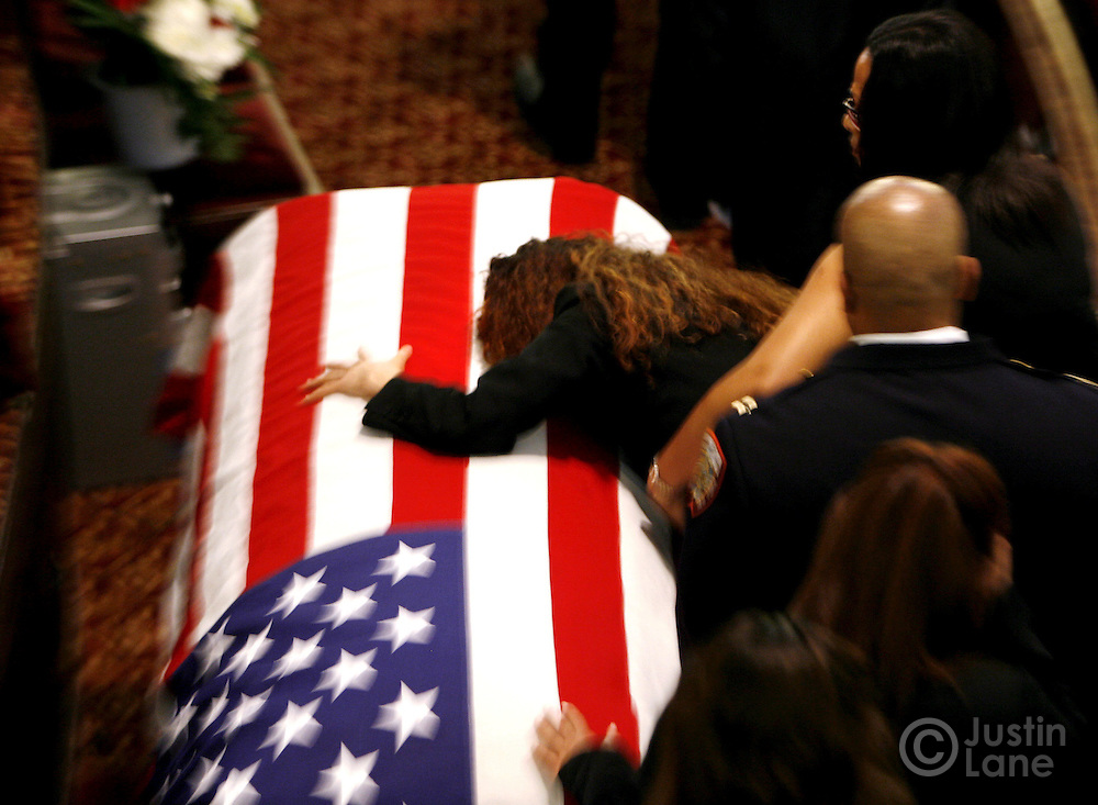 Annette Whyte grieves over the casket of her late son, United States Marine Lance Cpl. Nicholas J. Whyte, during his funeral at the Bedford Central Presbyterian Church in Brooklyn, New York on Friday 30 June 2006. Whyte was killed on 21 June 2006 while serving in Iraq.