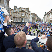 St Johnstone v Dundee United....18.05.14   William Hill Scottish Cup Final<br /> David Wotherspoon, Tom Scobbie, Brian Easton and James Dunne display the Scottish Cup on the open top bus parade as it enetrs Perth High Street.<br /> Picture by Graeme Hart.<br /> Copyright Perthshire Picture Agency<br /> Tel: 01738 623350  Mobile: 07990 594431