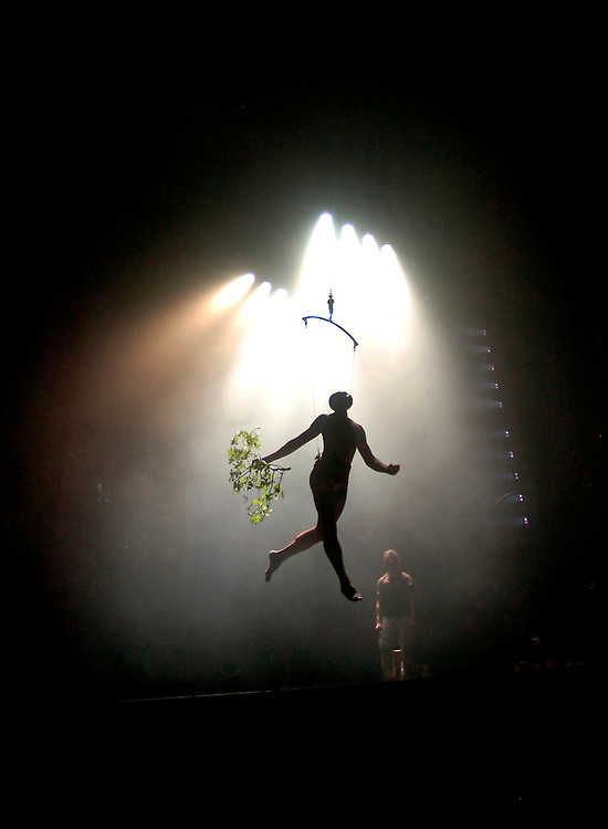 "NEW YORK, NEW YORK--11/5/08--A cast memeber of  ""The Garden of Earthly Delights"" carries a branch as he performs an aerial act on stage of the Minetta Lane Theatre during show's first full dress rehearsal Wednesday, Nov. 5, 2008, in New York, NY. Director Martha Clarke has revived her original show by the same title, a piece inspired by the Hieronymous Bosch painting, which first debuted on Broadway nearly 25 years ago. The show will open for a limited run on Nov. 19, 2008. GLENN FAWCETT"