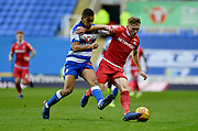 Reading midfielder Andy Rinomhota (35) and Nottingham Forest midfielder Ben Osborn (11) during the EFL Sky Bet Championship match between Reading and Nottingham Forest at the Madejski Stadium, Reading, England on 12 January 2019.