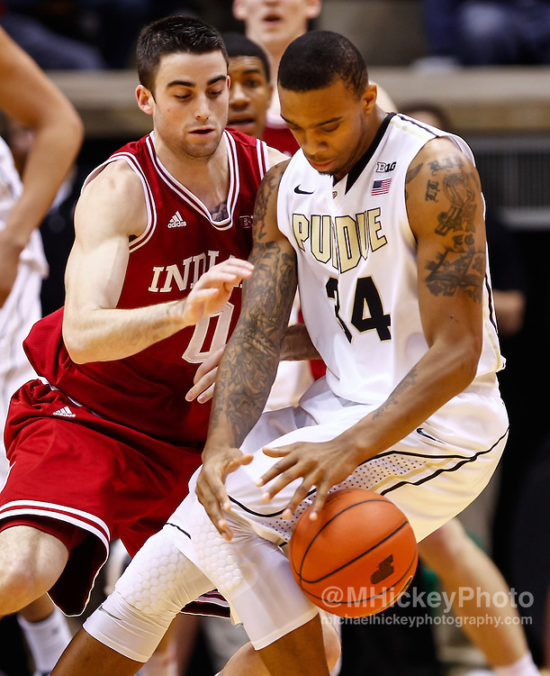 WEST LAFAYETTE, IN - JANUARY 30: Will Sheehey #0 of the Indiana Hoosiers guards Jacob Lawson #34 of the Purdue Boilermakers at Mackey Arena on January 30, 2013 in West Lafayette, Indiana. Indiana defeated Purdue 97-60. (Photo by Michael Hickey/Getty Images) *** Local Caption *** Will Sheehey; Jacob Lawson