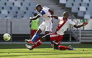 CAPE TOWN, South Africa - Saturday 26 January 2013, Anatole Ngamukol of Grasshopper Club Zurich kicks the ball as Thulani Hlatswayo of Ajax Cape Town challenges him during the soccer/football match Grasshopper Club Zurich (Switzerland) and Ajax Cape Town at the Cape Town stadium..Photo by Roger Sedres/ImageSA