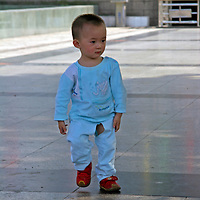 Asia, China, Chongqing. Chinese toddler with split pants - a method of toilet training in China.