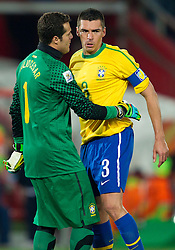 Julio Cesar and Lucio of Brazil celebrate during the 2010 FIFA World Cup South Africa Round of Sixteen match between Brazil and Chile at Ellis Park Stadium on June 28, 2010 in Johannesburg, South Africa. Brazil defeated Mexico 3-0 and qualified for quarterfinals.  (Photo by Vid Ponikvar / Sportida)
