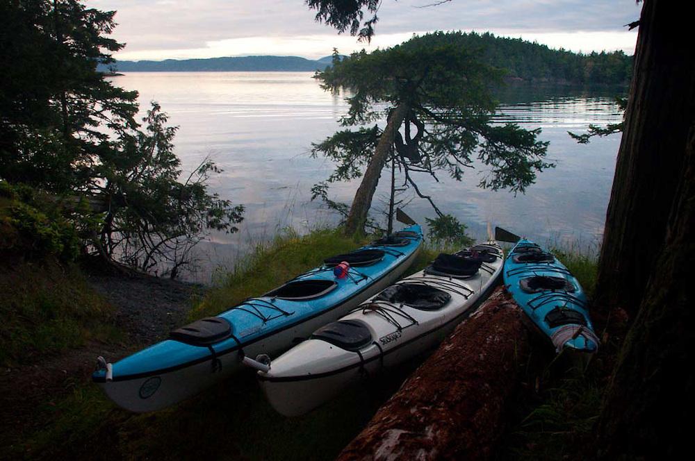 Kayaks at Prevost Harbor Campsite, Stuart Island, San Juan Islands, Washington, US