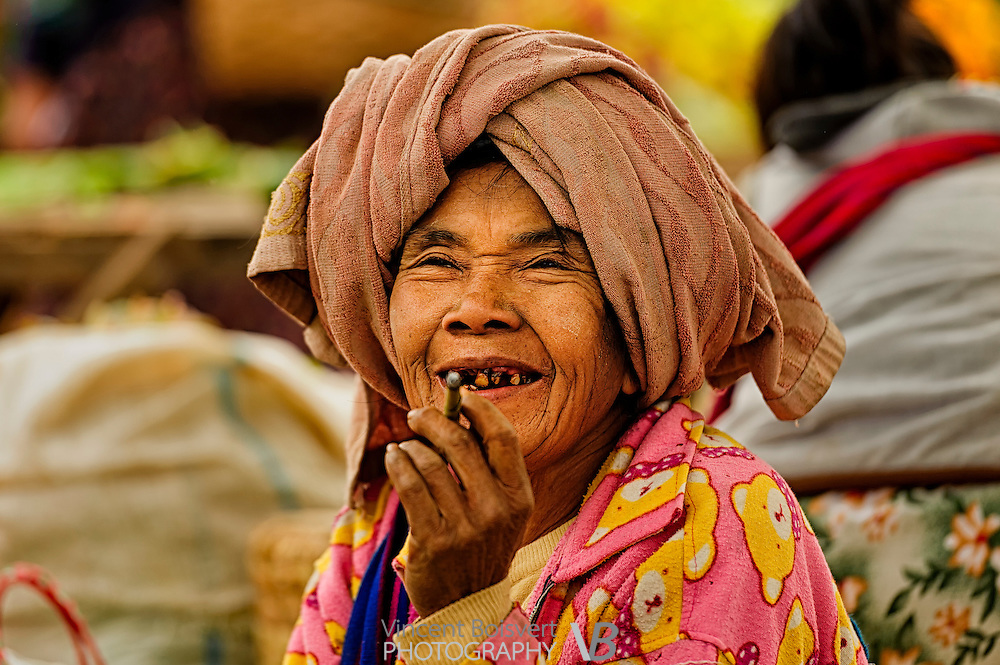 a Shan woman wearing a brown towel on a market day in kalaw, myanmar
