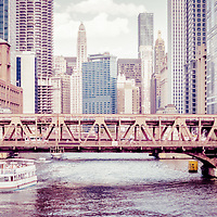 Chicago River skyline panorama vintage tonted picture of Wells Street Bridge and downtown Chicago city buildings. Panorama photo ratio is 1:3.