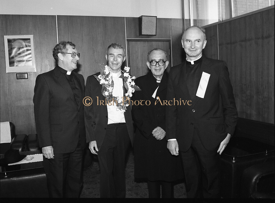 "Fr Niall O'Brien Returns from Captivity.1984..14.07.1984..07.14.1984..On 6 May 1983,Fr Niall O'Brien was arrested along with two other priests, Fr. Brian Gore, an Australian, Fr. Vicente Dangan, a Filipino and six lay workers - the so-called ""Negros Nine"", for the murders of Mayor Pablo Sola of Kabankalan and four companions. The priests where held under house arrest for eight months but ""escaped"" to prison in Bacolod City, the provincial capital, where they felt they would be safer.The case received widespread publicity in Ireland and Australia, the home of one of the co-accused priests, Fr. Brian Gore. When Ronald Reagan visited Ireland in 1984, he was asked on Irish TV how he could help the missionary priest's situation. A phone call the next day from the Reagan administration to Ferdinand Marcos resulted in Marcos offering a pardon to Fr. O'Brien and his co-accused..(Ref Wikipedia)...Image shows Fr Niall  O'Brien with members of his order in the V I P Lounge in Dublin Airport."