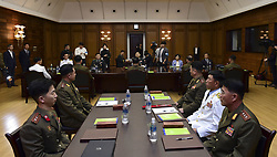 June 14, 2018 - Seoul, South Korea - June 14, 2018-Panmungak, North Korea-North Korean and South Korean Military delegates meet with talk during a Inter-Korean Military talk at Panmungak, North Korea. South and North Korea are holding their first high-level military talks in more than 10 years Thursday to discuss ways to ease cross-border tensions. The meeting started at 10 a.m. on the northern side of the truce village of Panmunjom, according to Seoul's defense ministry. These were the first such talks since the two sides met in December 2007.  South Korea's five-member delegation is led by Major General Kim Do-gyun. The North's delegation is led by Lieutenant General An Ik-san, who is accompanied by four other officials. (Credit Image: © Ryu Seung-Il via ZUMA Wire)