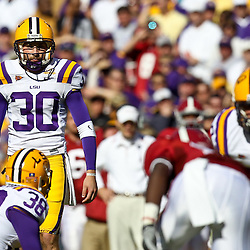 November 6, 2010; Baton Rouge, LA, USA; LSU Tigers kicker Josh Jasper (30) lines up for a kick during the first half against the Alabama Crimson Tide at Tiger Stadium.  Mandatory Credit: Derick E. Hingle