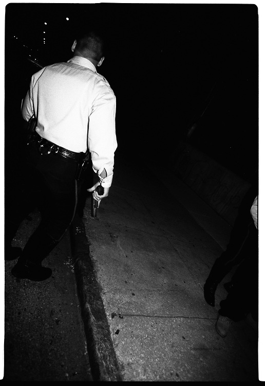 """Guns drawn during a pedestrian stop in """"the badlands"""" for a man with a gun."""
