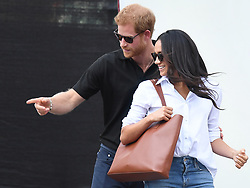 Prince Harry and Meghan Markle attend the Wheelchair Tennis at the Invictus Games in Nathan Square, Toronto, Ontario, Canada, on the 25th September 2017. 23 Sep 2017 Pictured: Prince Harry and Meghan Markle attend the Wheelchair Tennis at the Invictus Games in Nathan Square, Toronto, Ontario, Canada, on the 25th September 2017. Picture by James Whatling. Photo credit: James Whatling / MEGA TheMegaAgency.com +1 888 505 6342