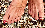 Berta Smith's toes are decorated in island symbols, she a longtime island resident and concerned about the loss to their paradise from recent eruptions on Tuesday, June 5, 2018, in Kona, Hawaii. Photo by LE Baskow