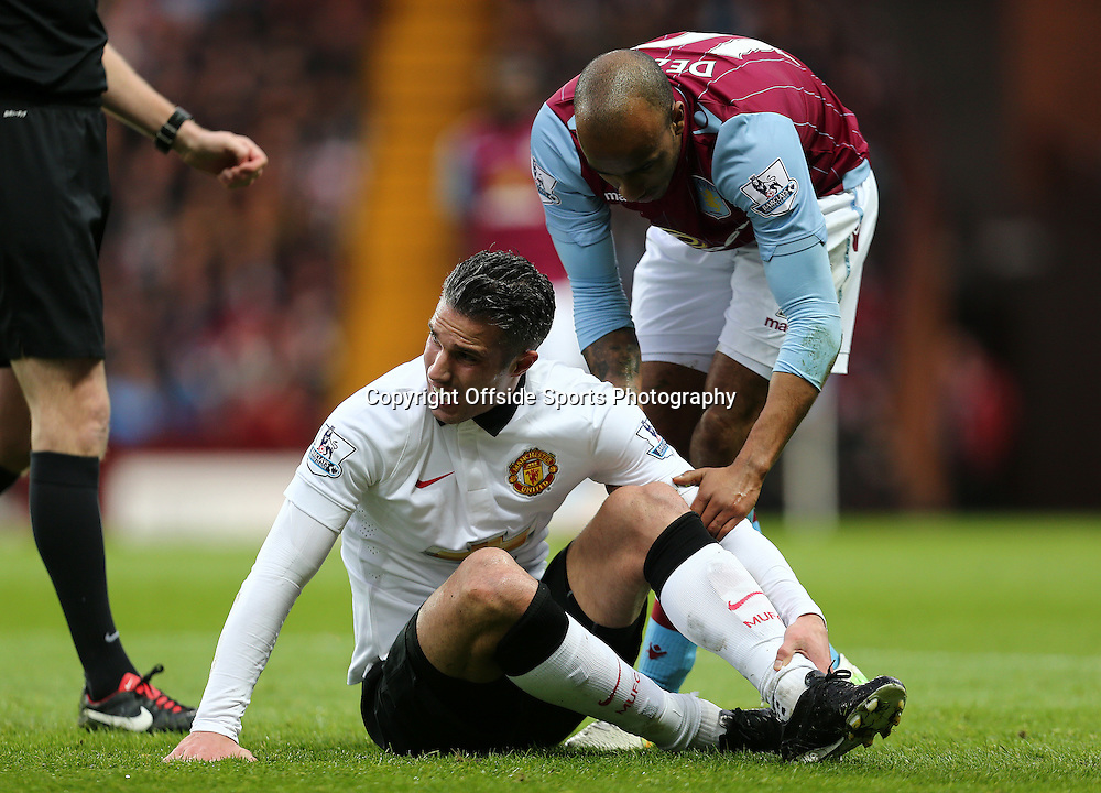20th December 2014 - Barclays Premier League - Aston Villa v Manchester United - \Robin Van Persie of Manchester United reacts after a foul by Fabian Delph of Aston Villa - Photo: Paul Roberts / Offside.