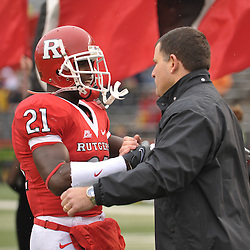 Dec 5, 2009; Piscataway, NJ, USA; Rutgers head coach Greg Schiano shakes hands with cornerback Devin Mccourty during the senior ceremony before first half NCAA Big East college football action between Rutgers and West Virginia at Rutgers Stadium.